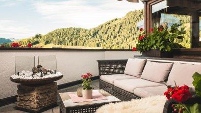 Sonnenterrasse mit Loungemöbeln