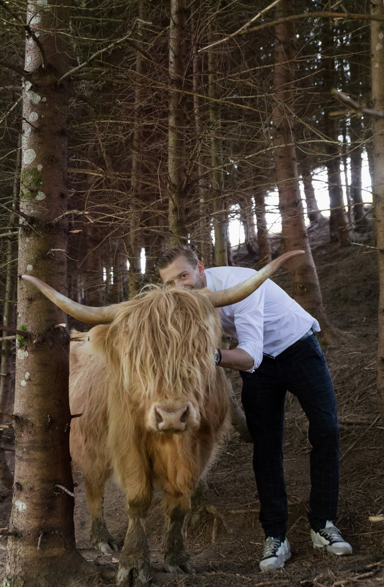 Stephan with one of his beloved Scottish highland cows.