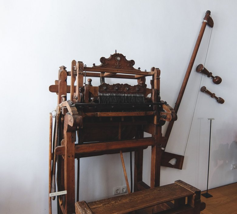 A harbinger of industrialization: A basic knitting machine that was used to produce stockings in the 18th century.