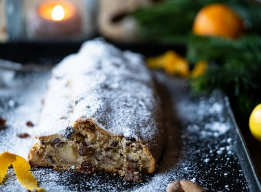 Cover the Stollen with melted clarified butter and finally add a thick layer of icing sugar.