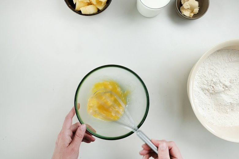 Place the eggs in a different bowl and beat them.