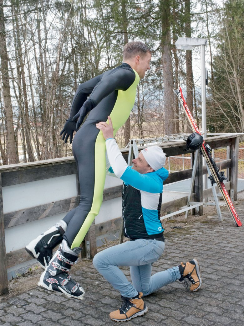 During this exercise, ski-flying pros jump from a standing position into the arms of their coach, who is standing with his or her arms stretched above their head. Our author still needs to practice.