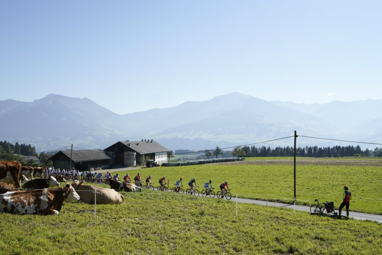Racing first took the riders across Lower Inntal Valley, past grazing cows and farmsteads.