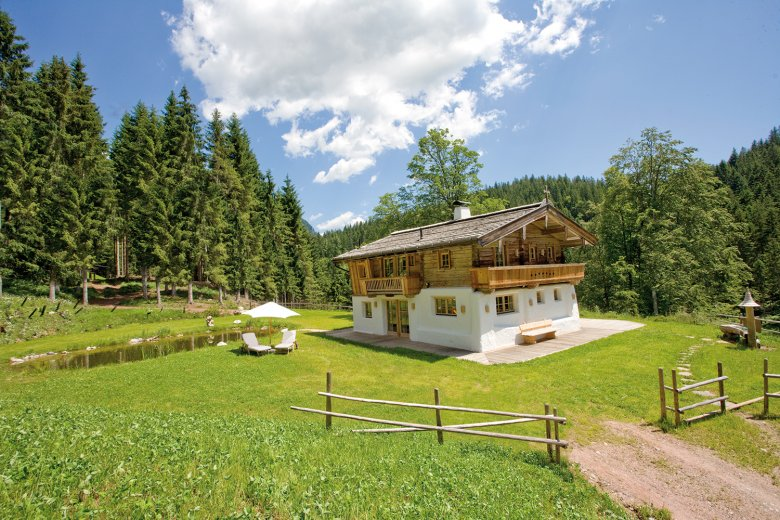 Hüttlingmoos luxurious chalet-style accommodation is a most romantic hideaway. Photo Credit: Stanglwirt/Dahan