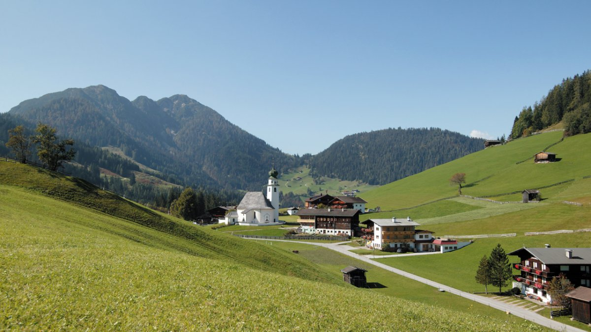 A beautiful playground of alpine pastures, old traditions and quaint mountain villages, Wildschönau is made for summer holidays. 300 kilometres of walking trails crisscross the region, and mountaintop bike paths make exploring easy. Families are well catered for too, with swimming pools, horse riding and museums all on its doorstep., © Wildschönau Tourismus