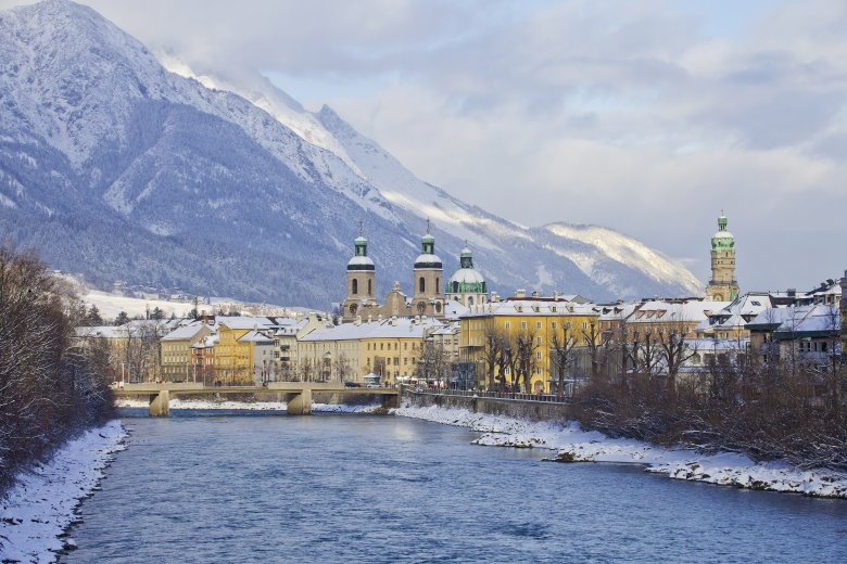 View of Inn River Bridge at the gateway to Innsbruck's historic old town.