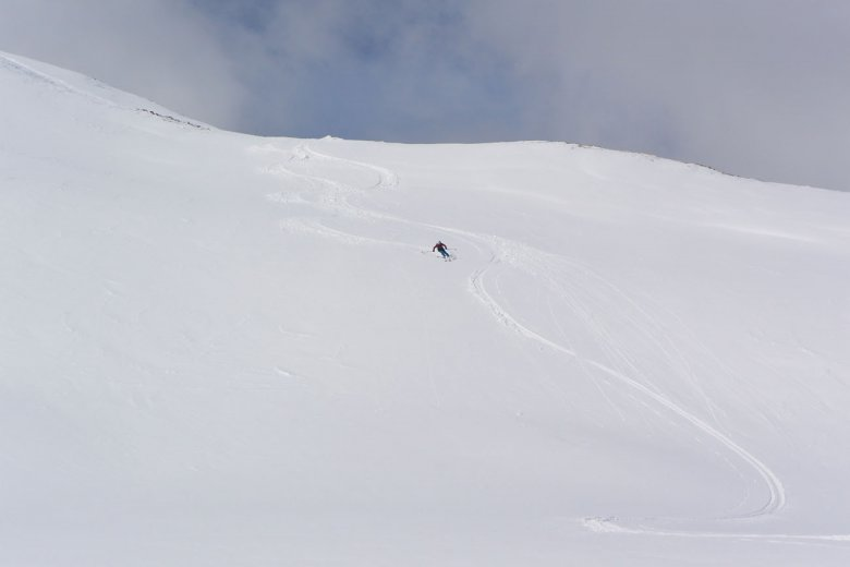 First Tracks at its very finest: Once we rip the skins off and ski down untracked snow into Villgraten Valley, it's like floating on clouds.