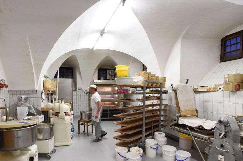 Brother Franz at work: The delectable baked goods are strictly prepared in house, in the vaulted bakery underneath Stams Abbey with the utmost care by the baking monk at night.