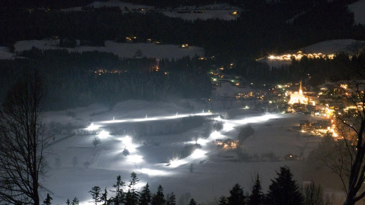 With its gentle and rhythmic movements, cross-country skiing is one of the most beautiful winter sports to do and watch and an especially exhilarating experience after dark., © Wilder Kaiser
