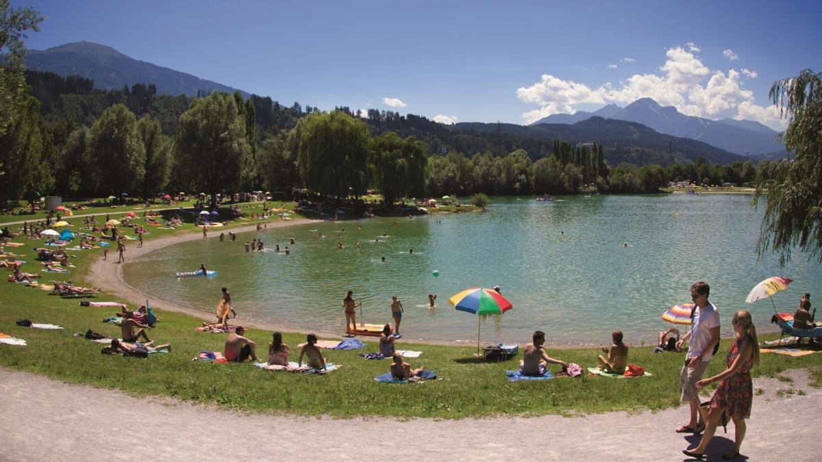 Who needs sunny Spain or Bella Italia when you can spend the day at the beautiful Lake Baggersee for a fraction of the price? This artificial lake in the east of the city offers plenty of activities away from the water and is popular with guests of all ages., © Innsbruck Tourismus