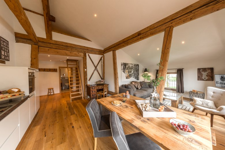 The interiors are a contemporary take on traditional Tirolean farmhouse style: Bauernlodge in scenic Lechtal Valley.