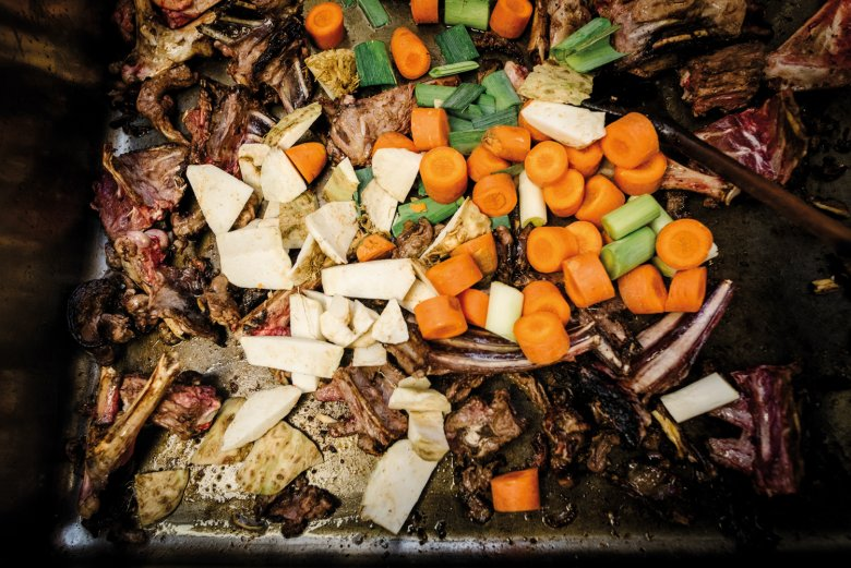 Root vegetables, herbs, bones and leftover meat go into making the jus.