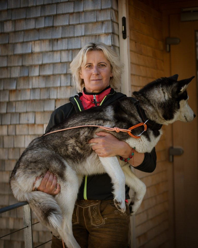 """Katharina Daum was 27 years old and a single mom to a seven-year-old boy when she was given the opportunity to operate a mountain hut. Today, 23 years later, Katharina and her son Manuel are still a close mother-son team, running the storied Olperer Hut in Zillertal Valley together with their Siberian Husky named """"Snowy""""."""