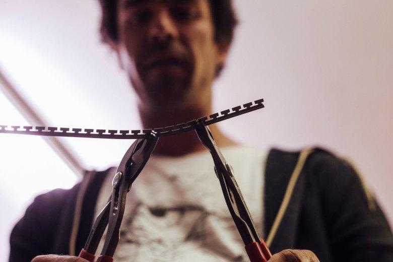 Benoît is bending edges by hand.