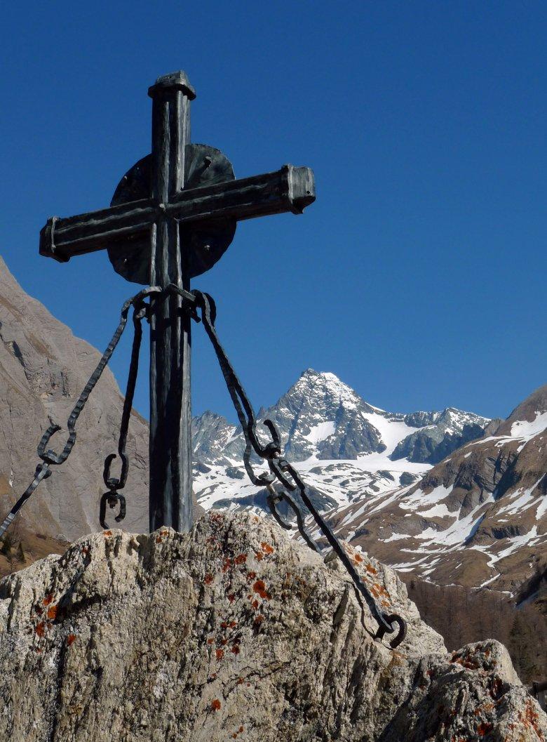 Summit cross atop the Großglockner mountain. Photo: Bernhard Aichner