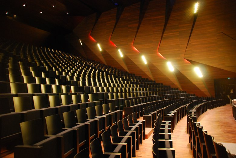 For superb acoustics, the Concert Hall is covered with stained acacia wood. Photo Credit: Tom Benz