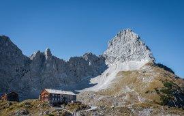 Towered by soaring Lamsenspitze Peak: Lamsenjoch Hut at Karwendel Mountain Range (c) Silberregion Karwendel