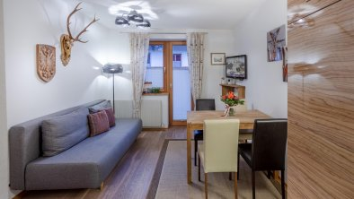 Wohnzimmer /Küchenbereich Tristner, © Alpen Appartements Mayrhofen