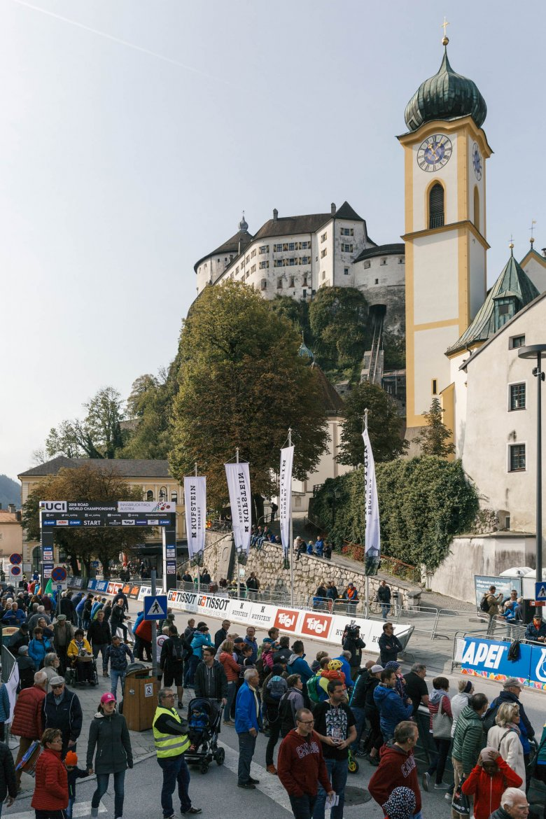 Scenic start: The elite men's course departed Kufstein, towered by the fortress of the same name.