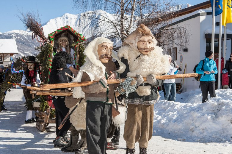 """Fisser Blockziehen"" sees local men drag a 35-metre-long tree through the village of Fiss on a wooden sledge. Photo: TVB Serfaus Fiss Ladis / Andreas Kirschner"