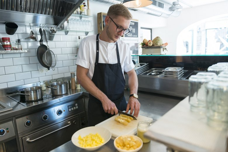 Thomas is cutting the grey cheese. Tirolean grey cheese is extremely low in fat, but it has a powerful penetrating smell.