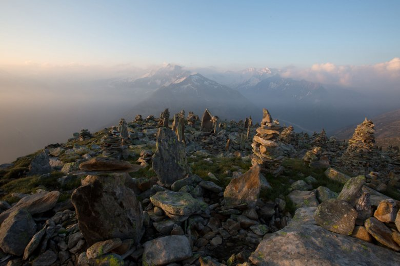 An army of rock cairns form an otherworldly setting at craggy Petersköpfl. Photo Credit: Tirol Werbung