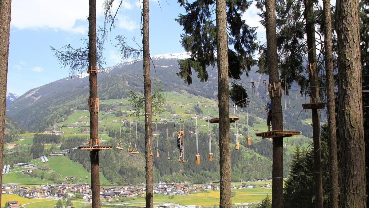With its high rope obstacle course and via ferrata fixed-rope climbing route leading over a waterfall, the outdoor adventure park in Kaltenbach offers nerve-jangling experiences and a great day out for all the family., © Outdoorcenter-Zillertal