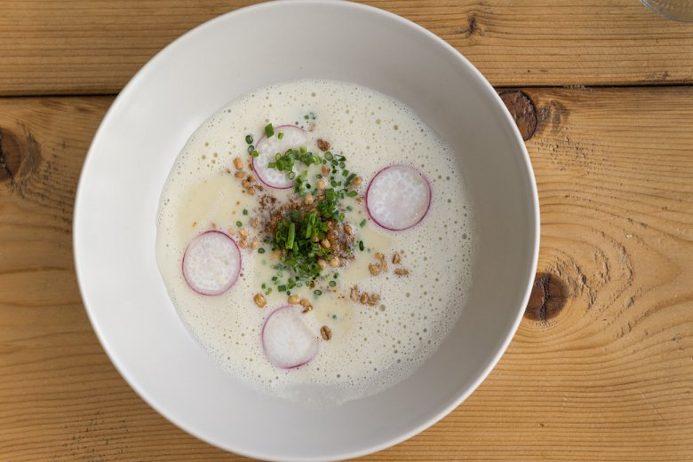 Garnish your grey cheese soup with thin slices of radish and sautéed rye bread cubes, if you like.