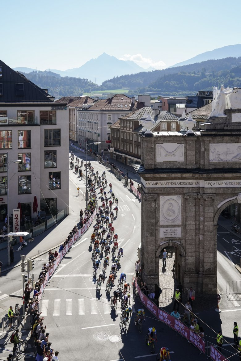 Riding next to the Triumphal Arch of Innsbruck.