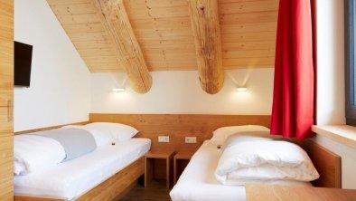 Schlafzimmer Obergeschoß mit getrennten Betten