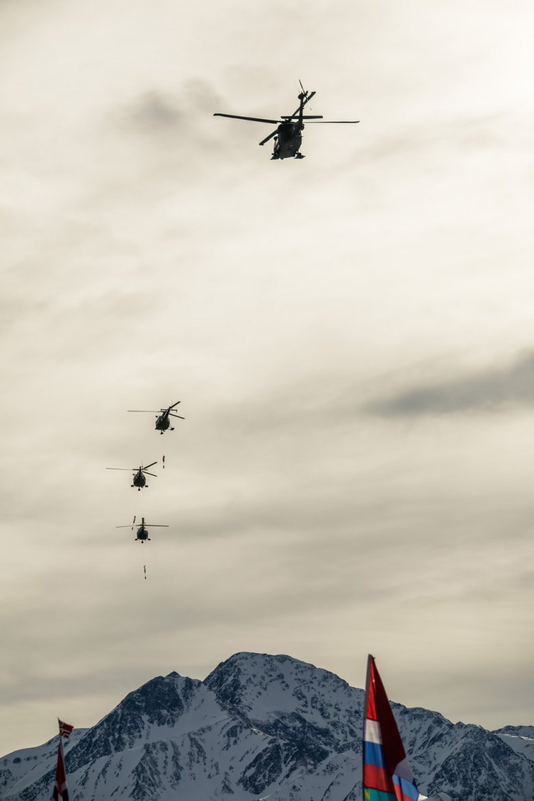 A helicopter transports the official FIS flag to the host town of the next FIS Nordic World Ski Championships: Oberstdorf in Germany.