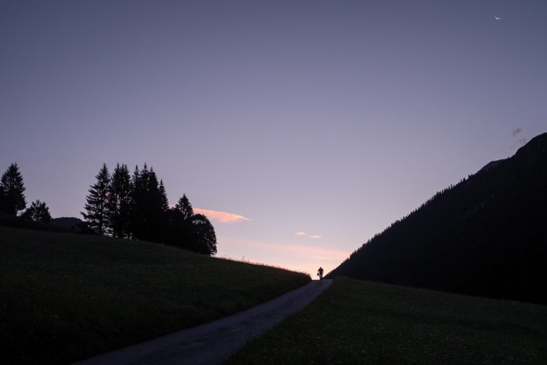 6.00 A.M. Rise and shine! A local walks near the village of Namlos as the sun slowly appears on the horizon.